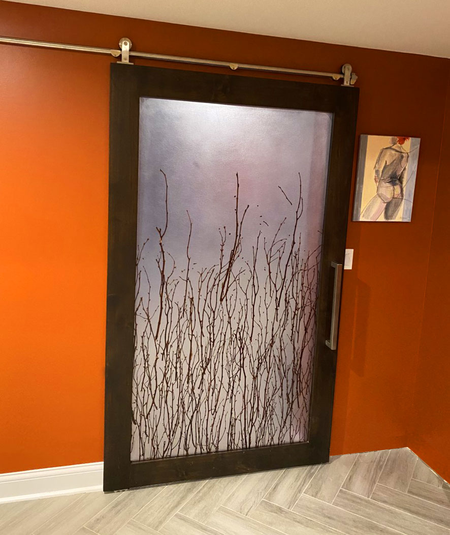 3Form barn door with stained wood frame