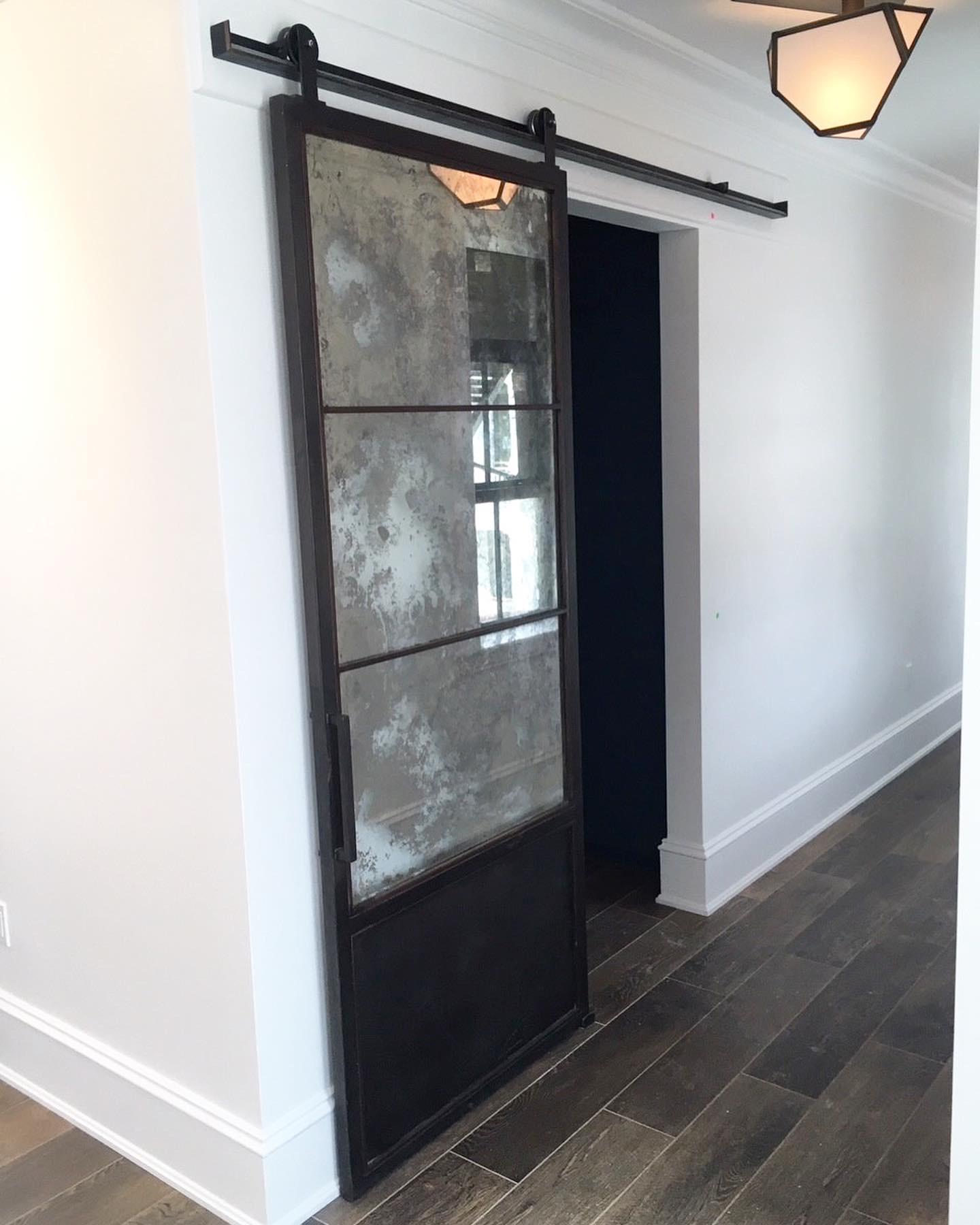 Antique Mirror and Metal Barn Door