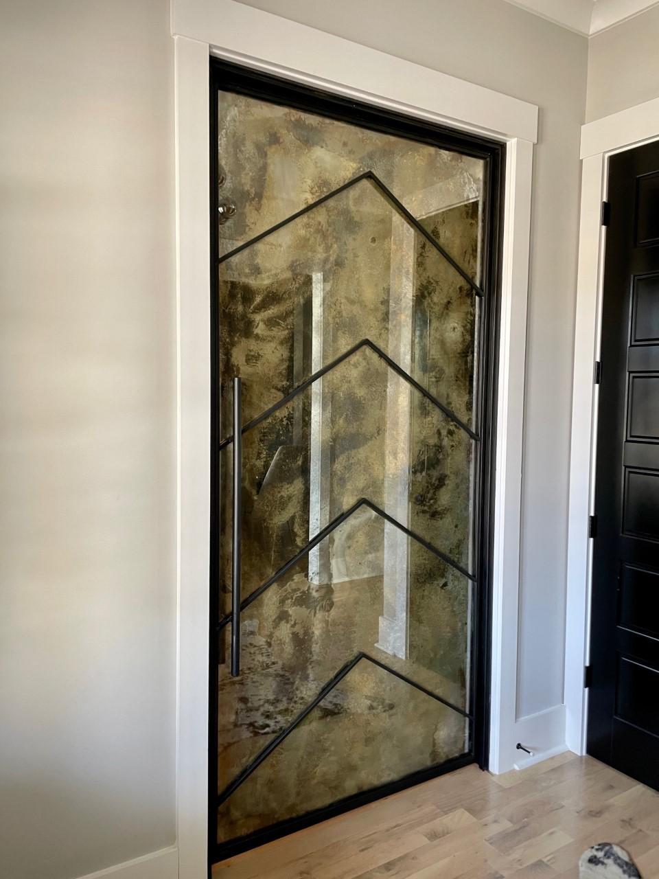 chevron pattern metal and antique mirror door