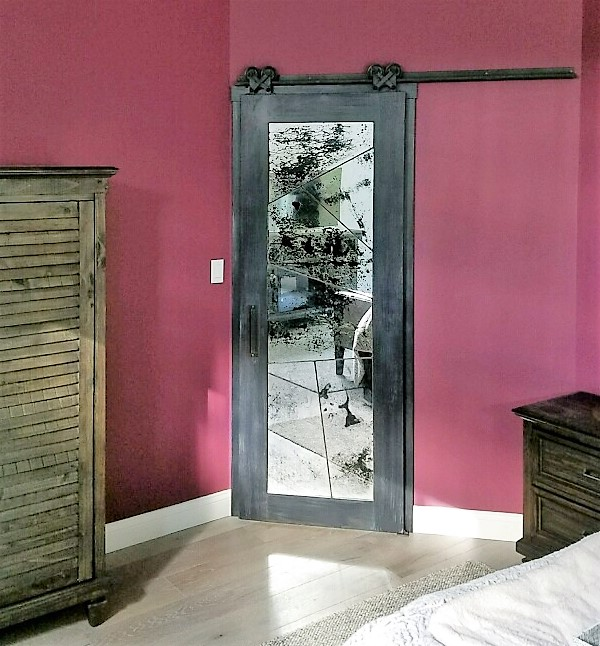 random cut antique mirrors with metal seams and a charred wood frame