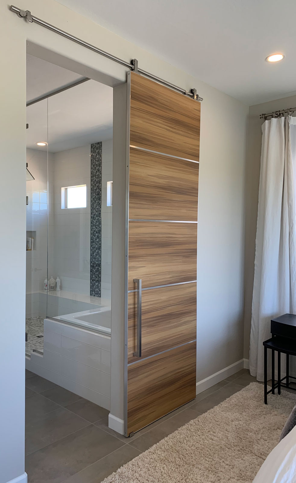 modern barn door with stainless hardware