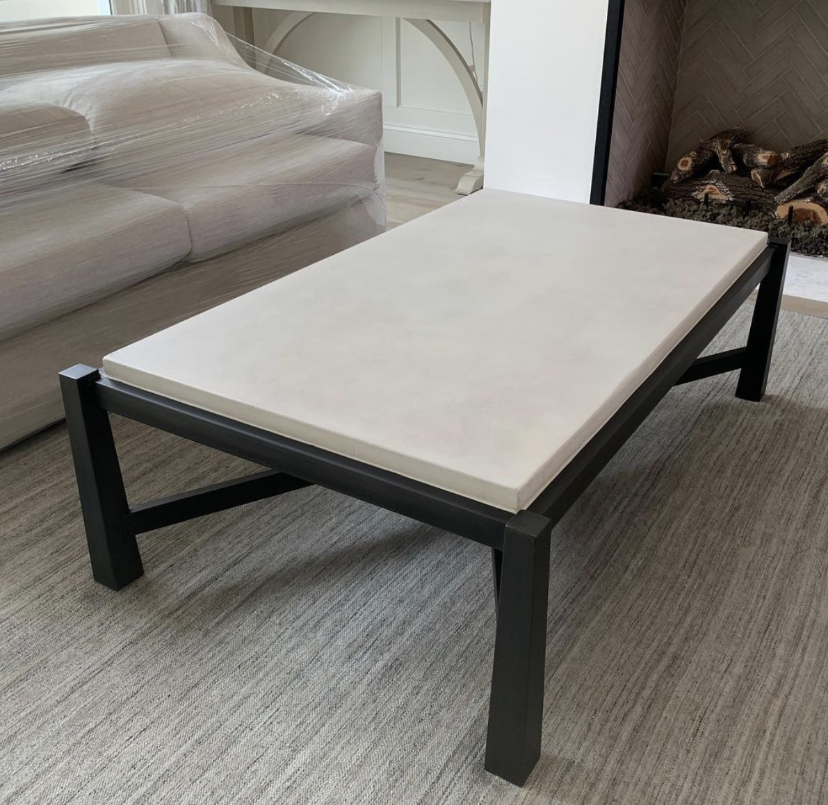 white concrete and black metal coffee table