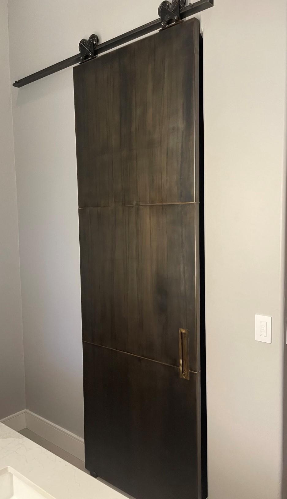 metal panel door with brass handle