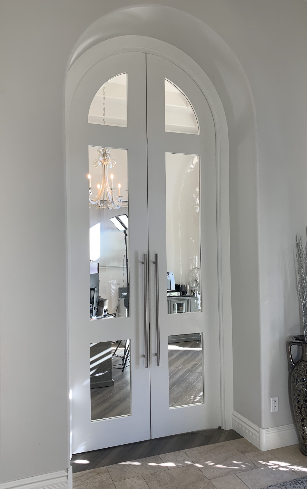 Large arched double painted doors with clear glass