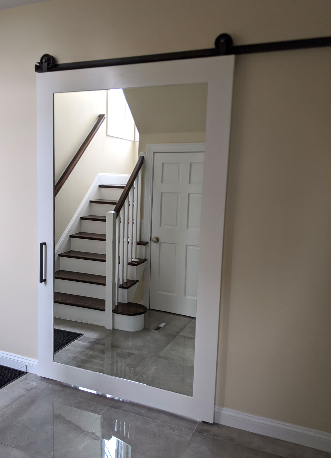 painted wood and mirror barn door