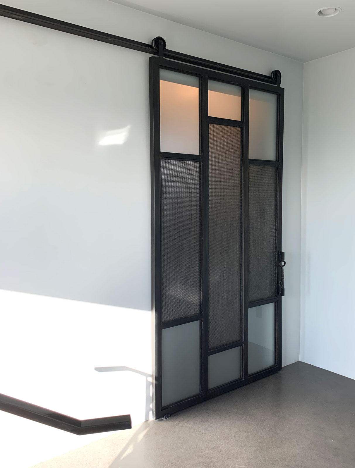 metal barn door with satin glass and wire mesh