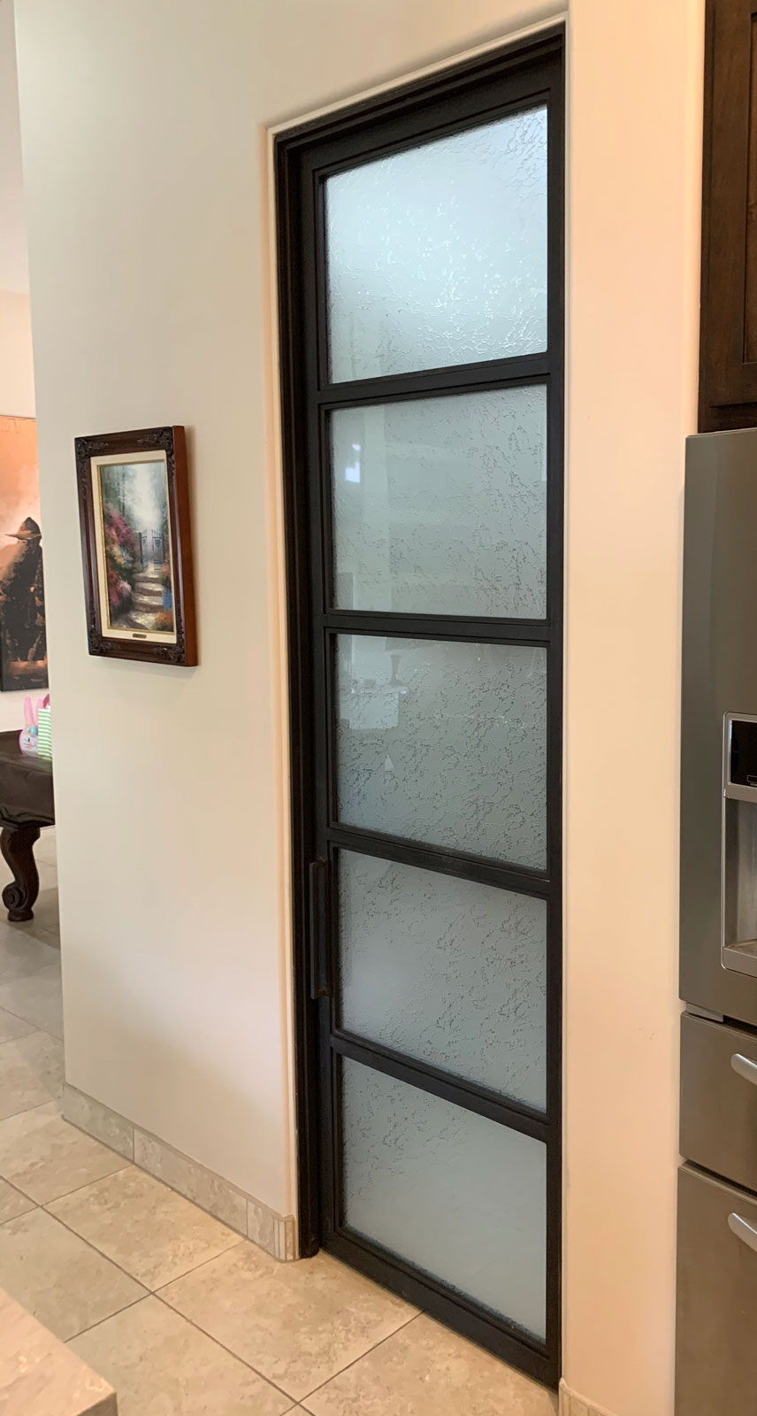 metal and textured glass pantry door