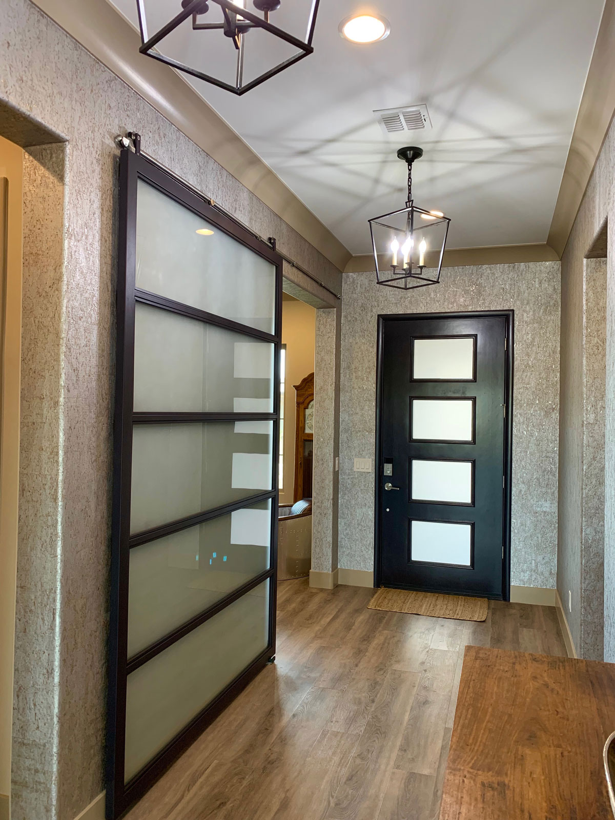 satin glass and metal barn door with stainless steel hardware