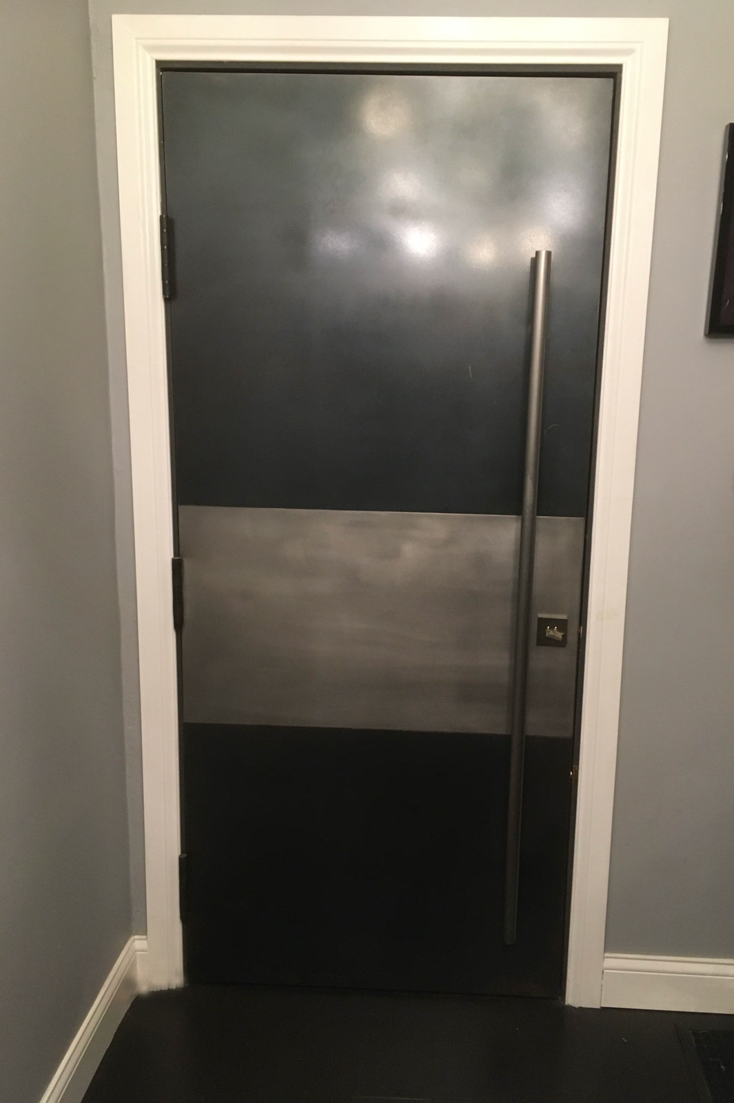 exterior front door with stainless steel and patina metal