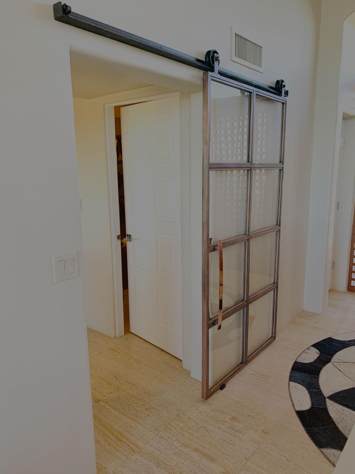 custom copper barn door and glass