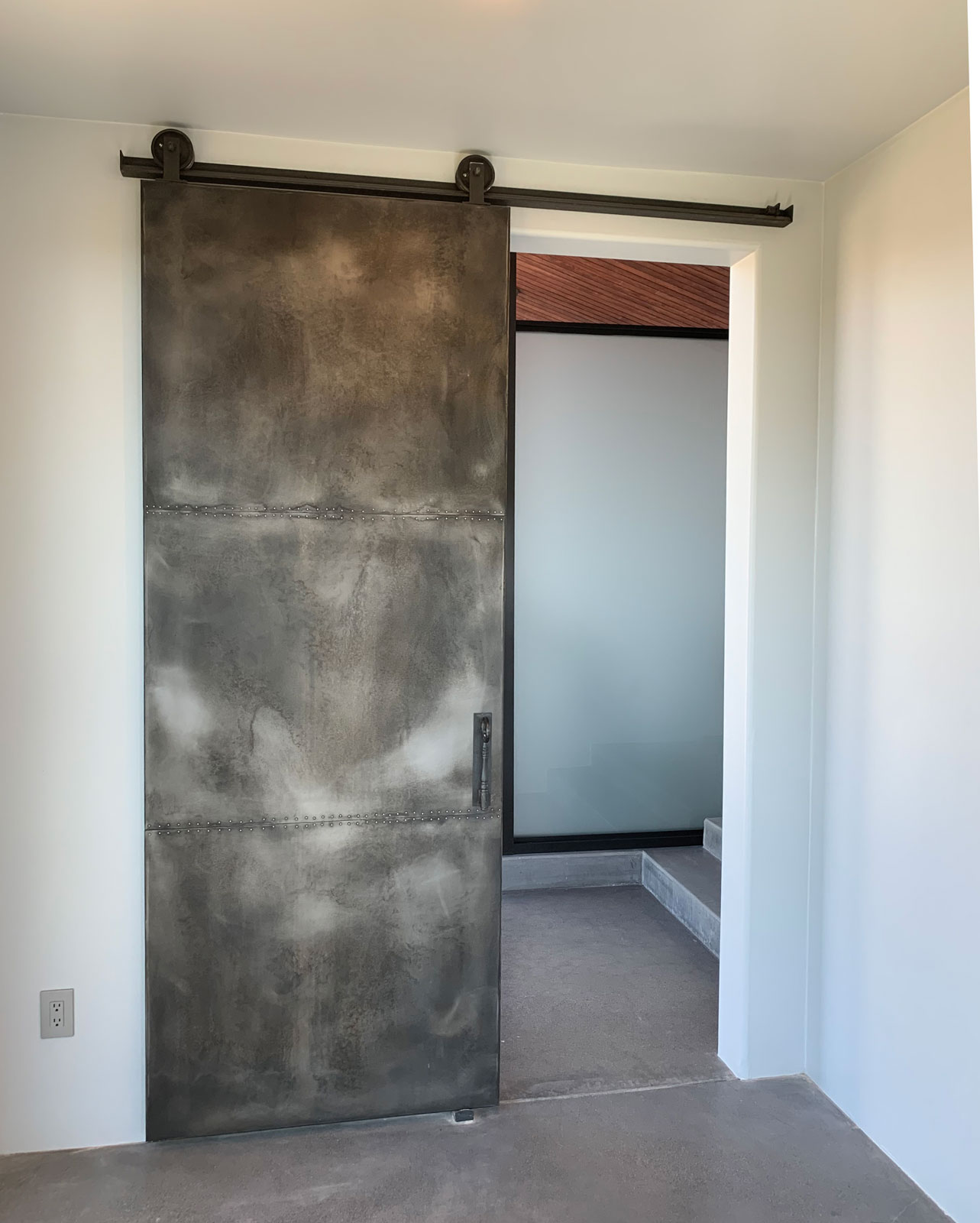 weathered zinc barn door with rivets