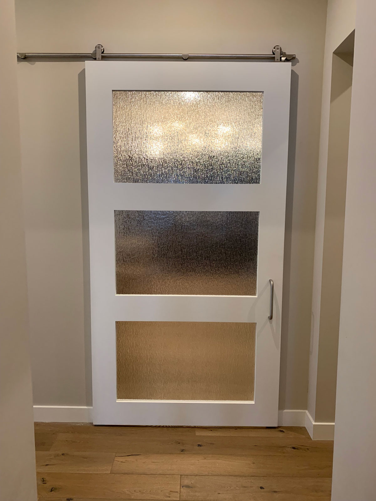 painted white shaker barn door with stainless steel hadware