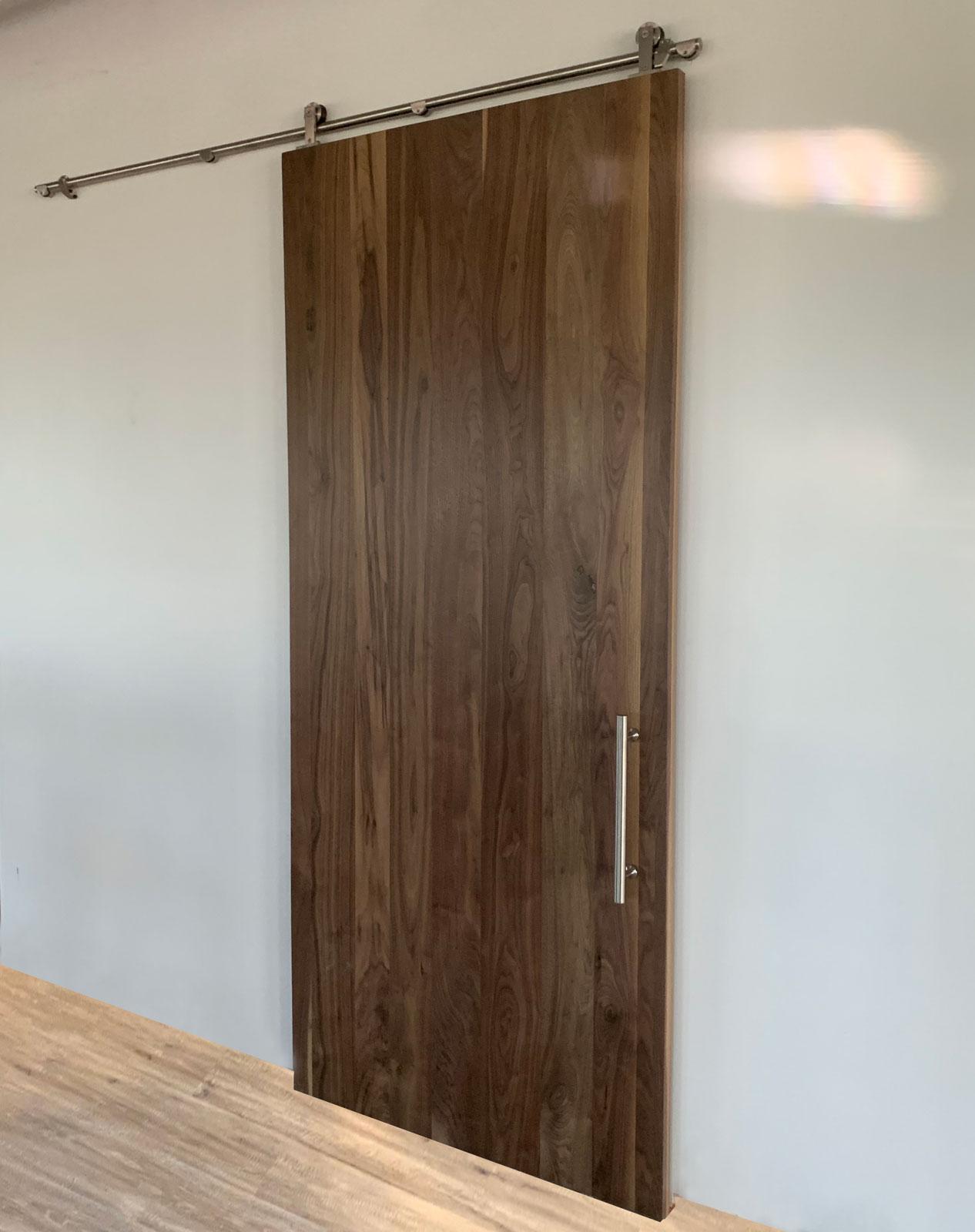 walnut barn door with stainless steel hardware