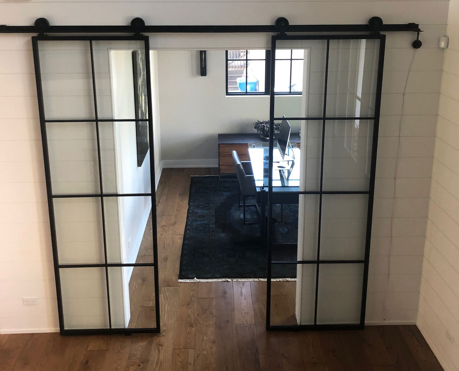 Contemporary metal and glass barn doors with thin metal frame
