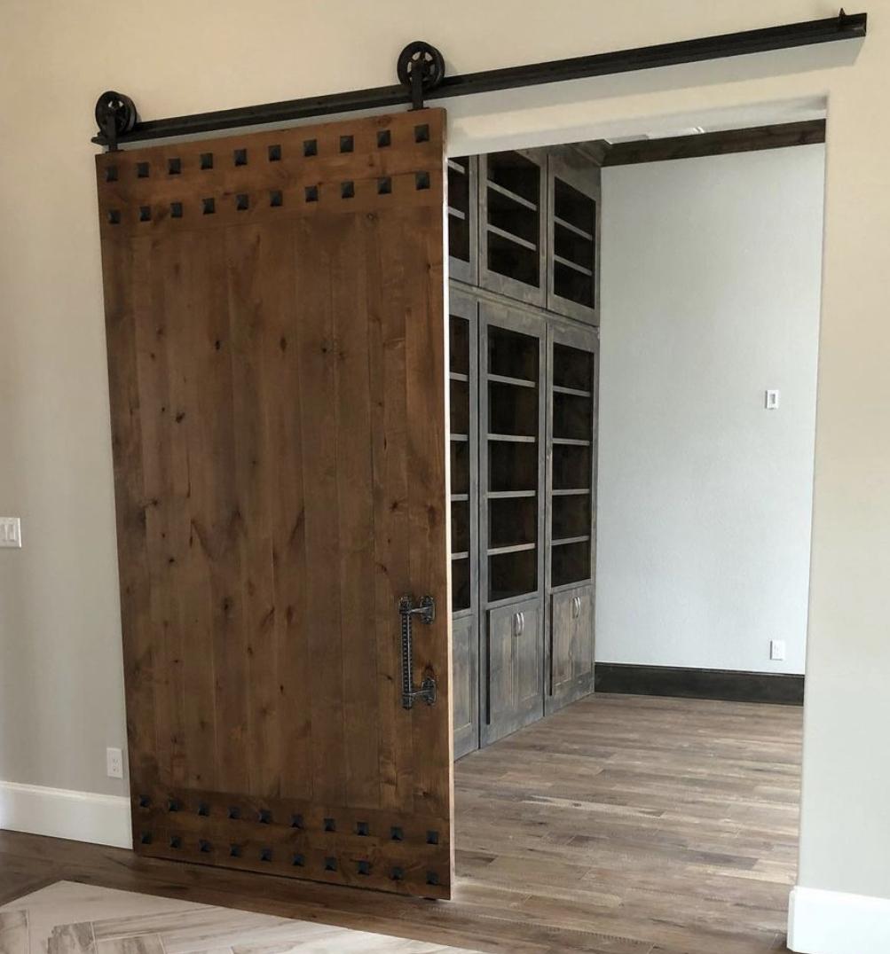 solid wood barn door with clavos