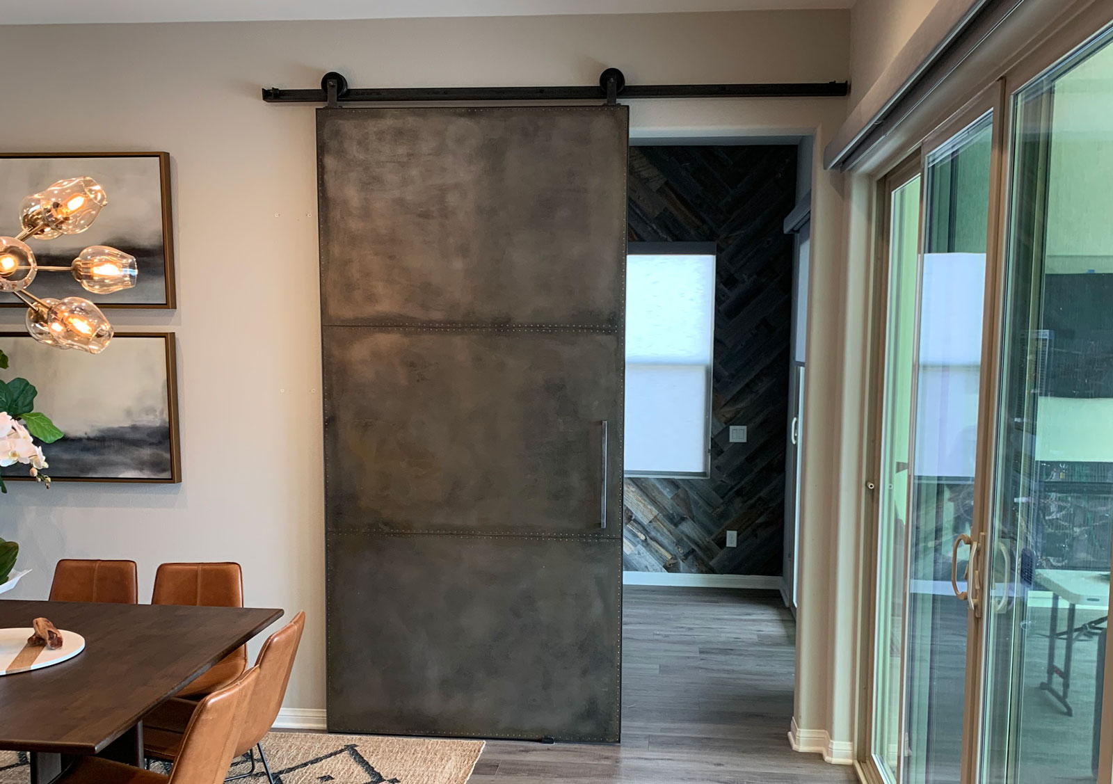 metal barn door with rivets and custom made hardware