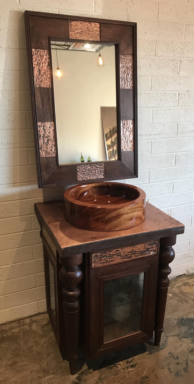 mahogany cabinet and copper vanity