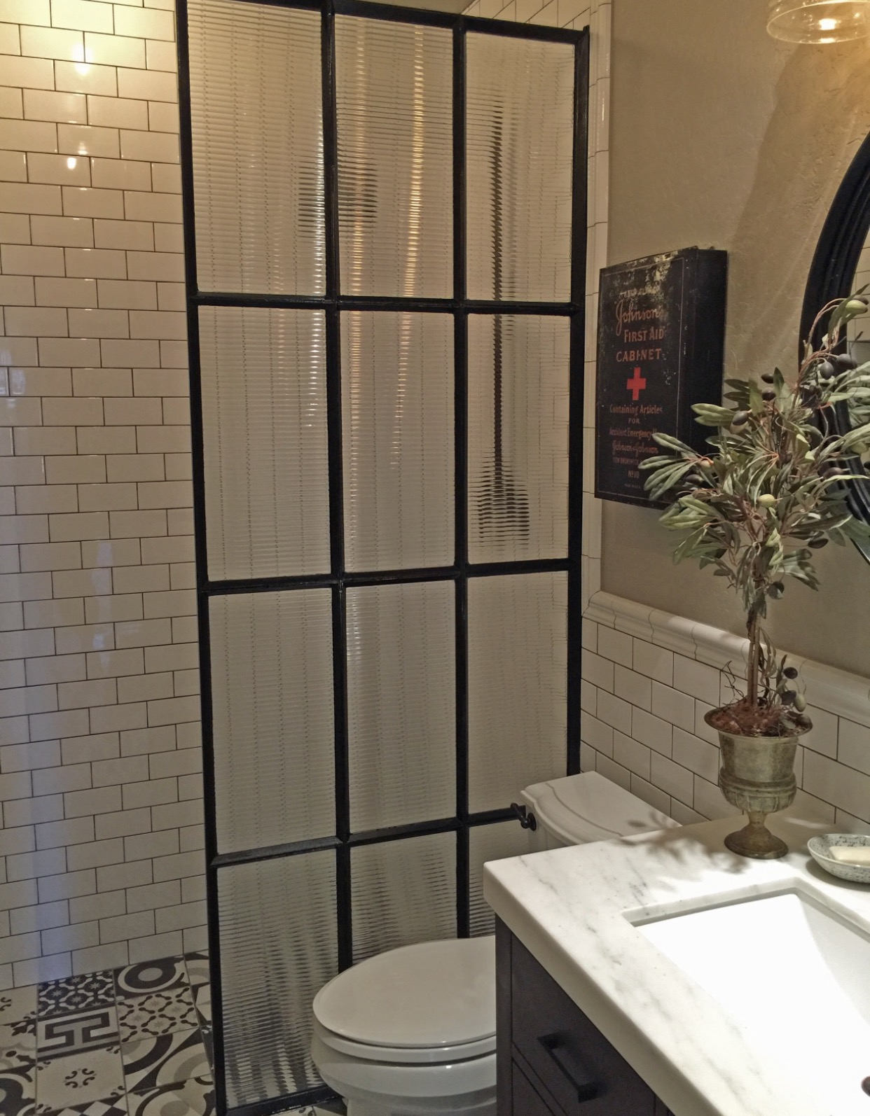 reeded glass and metal shower divider wall