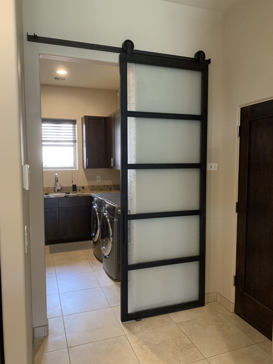 laundry room frosted glass and blacken metal barn door