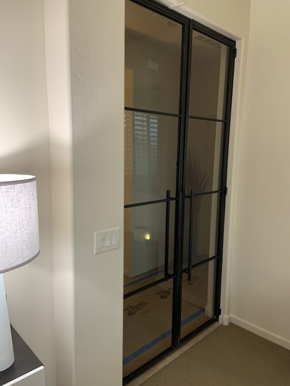 master bedroom contemporary metal and glass doors