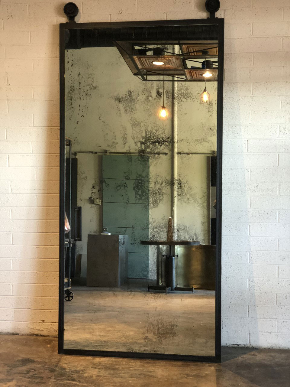 antique mirror with blackened frame