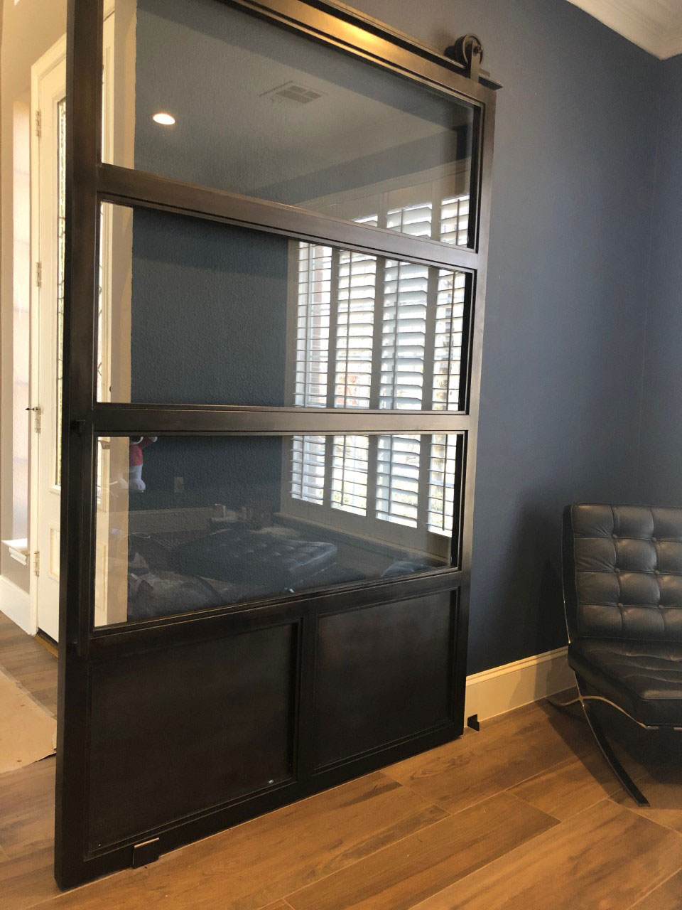 black steel and clear glass barn door