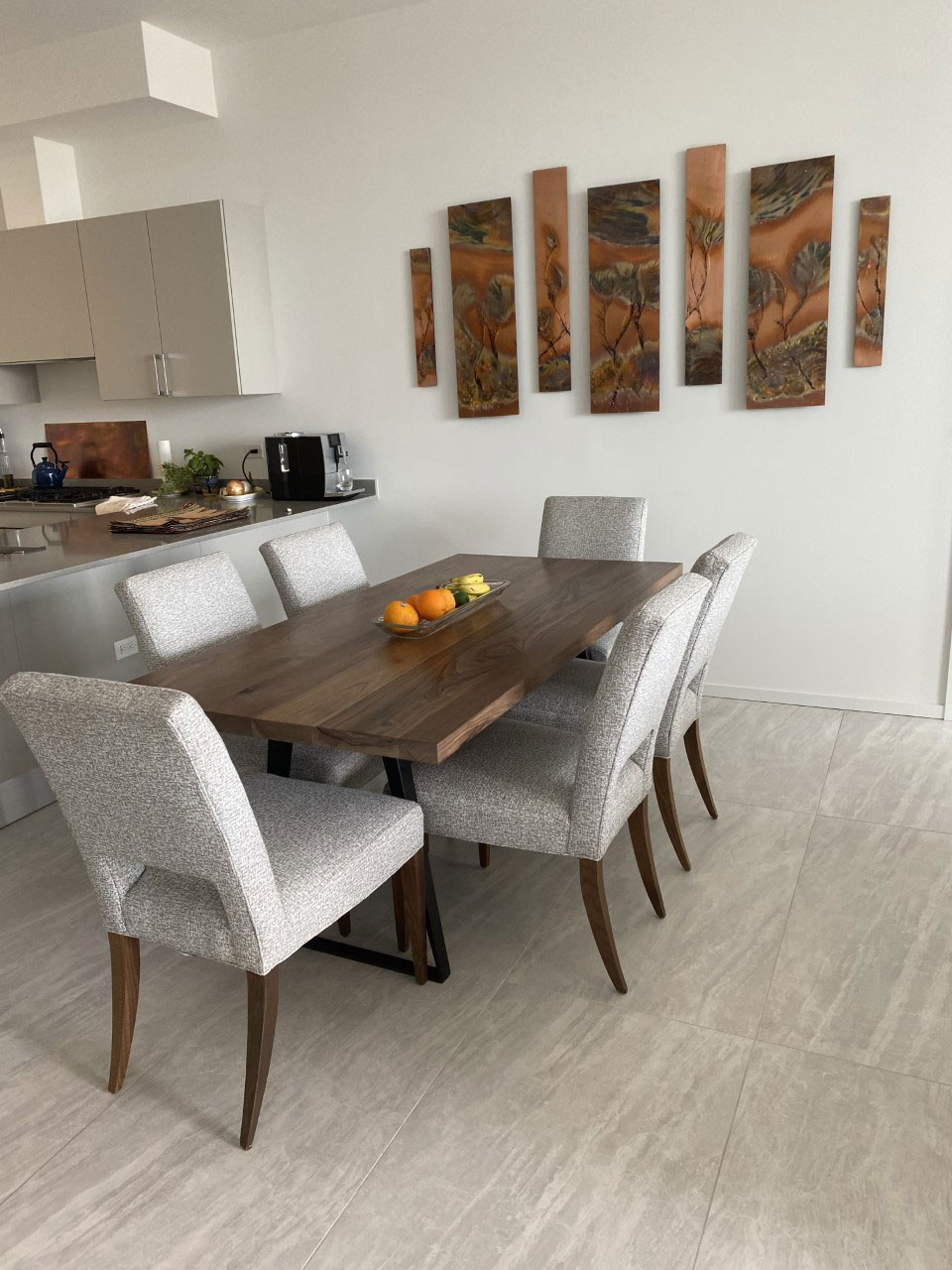 contemporary walnut dining table with metal tapered legs