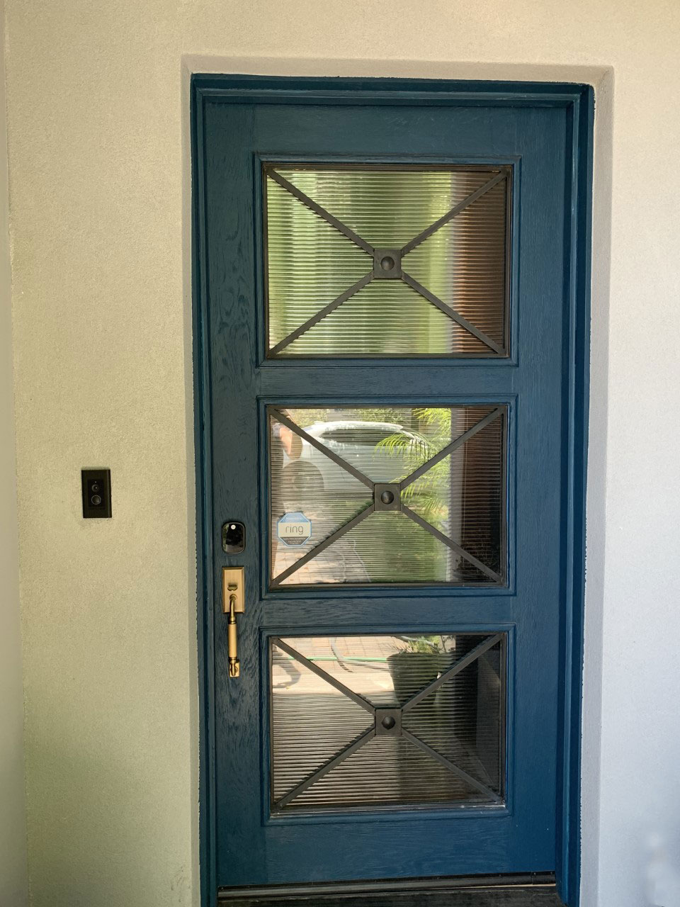 white oak and reeded glass entry door