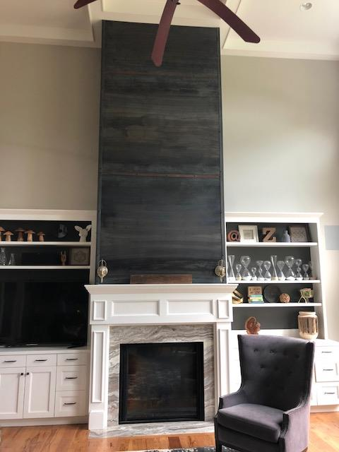 Steel wall facade above fireplace