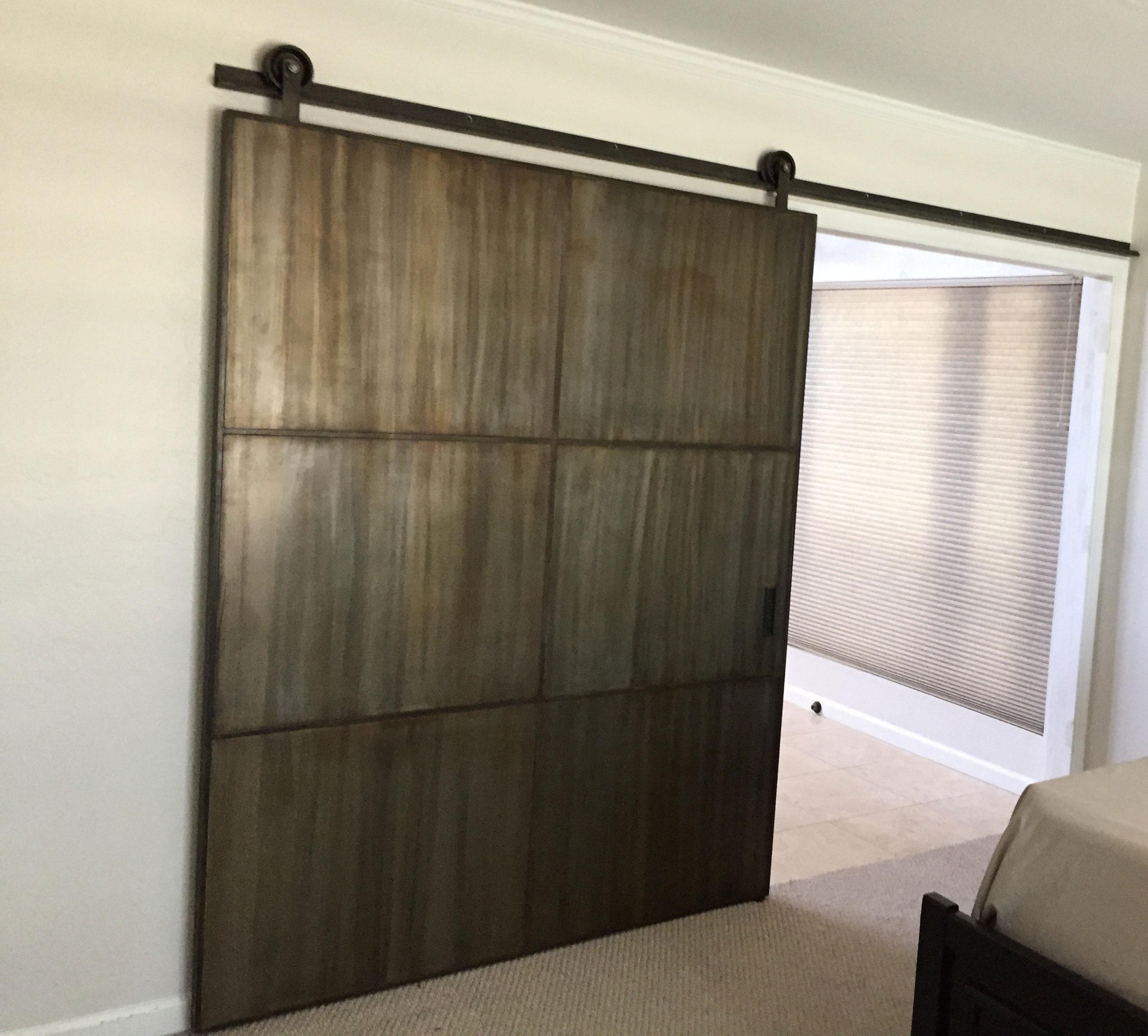 Large metal barn door with custom patina finish