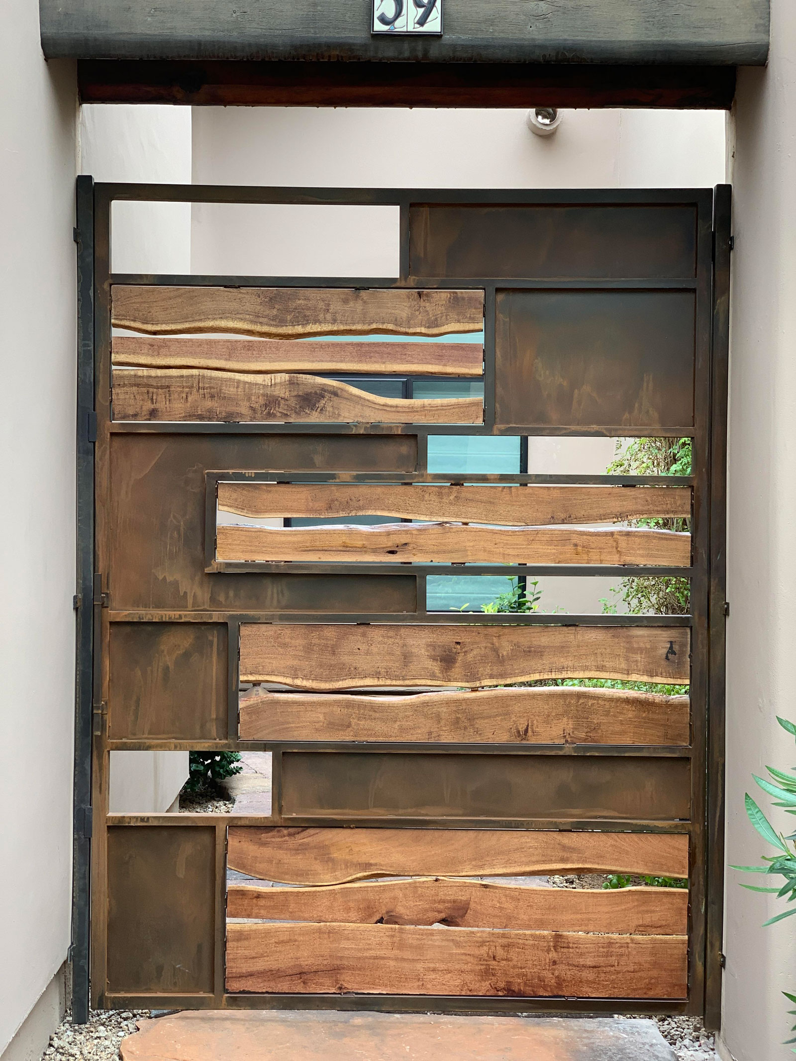mesquite wood and patina metal gate