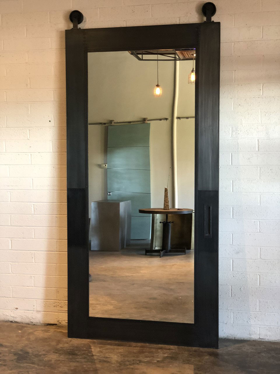 metal skinned panel with mirror inset barn door