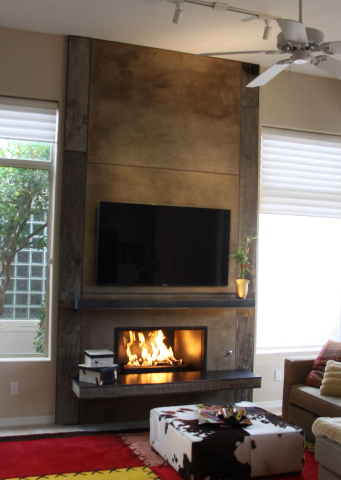 reclaimed wood and crete board fireplace with hot rolled mantle and hearth