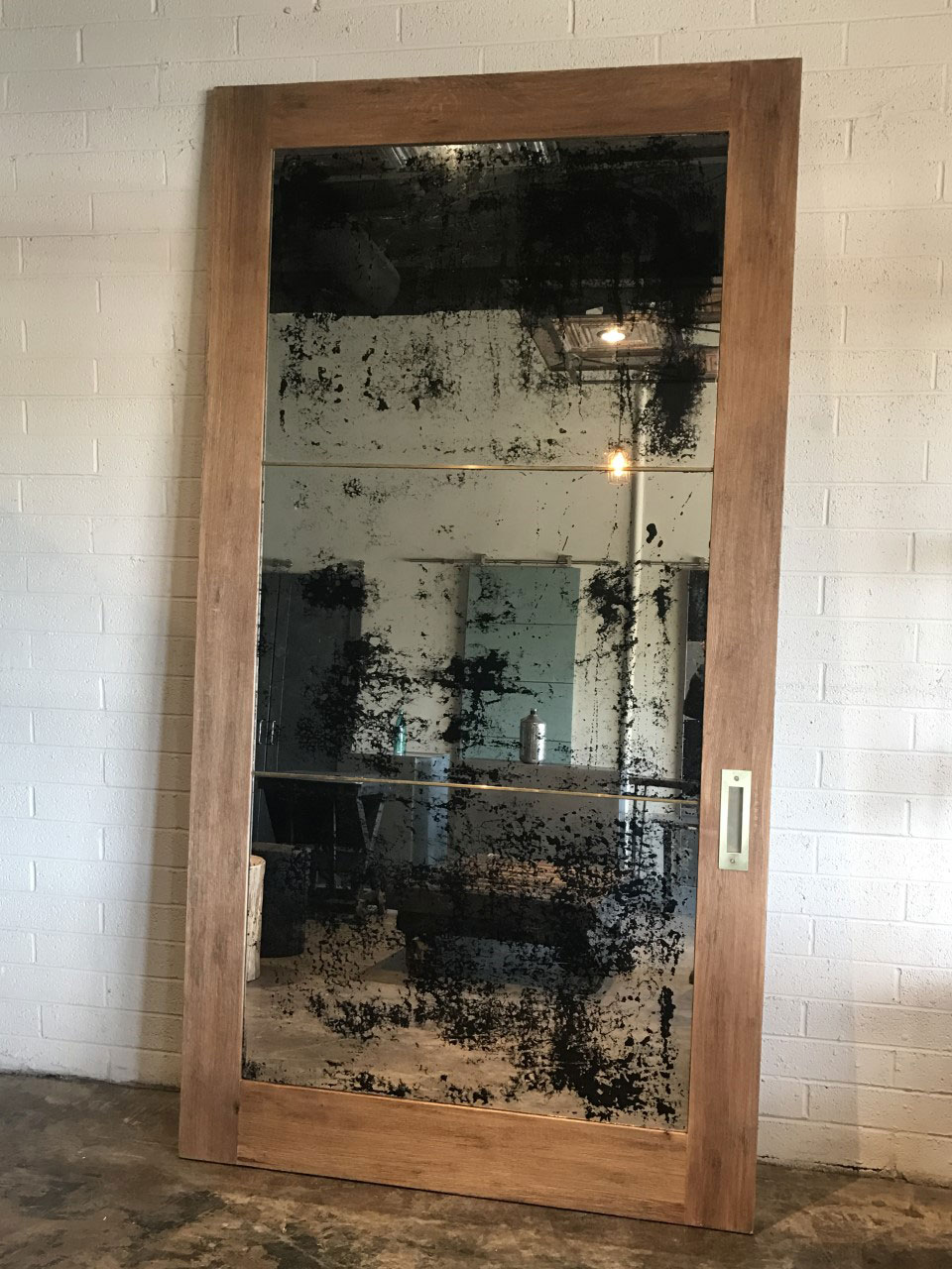 rift sawn oak and antique mirror barn door