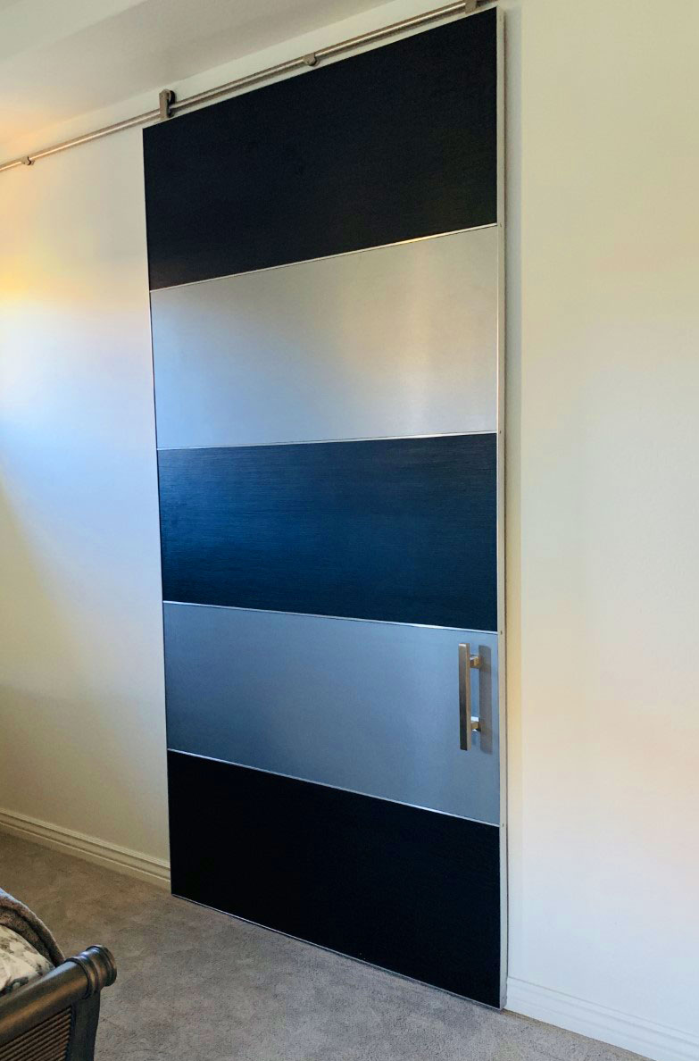 laminate modern barn door with stainless
