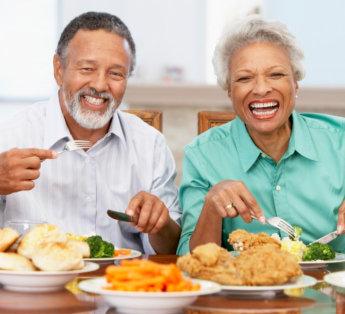 two elderly people laughing