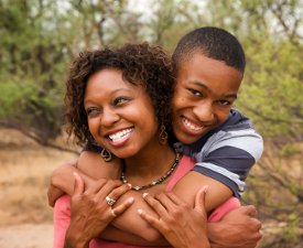 Recovery Coaching Packages | Happy African American Family: Mother and Son