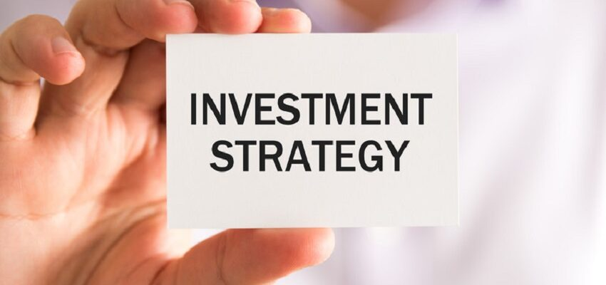 person holding card that reads investment strategy_canstockphoto44767026-2