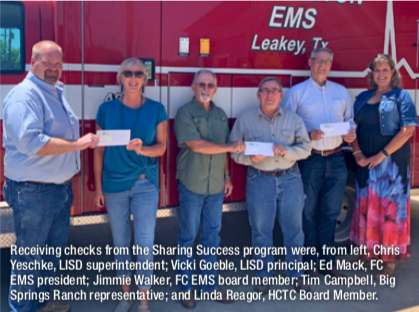 Receiving checks from the Sharing Success program.