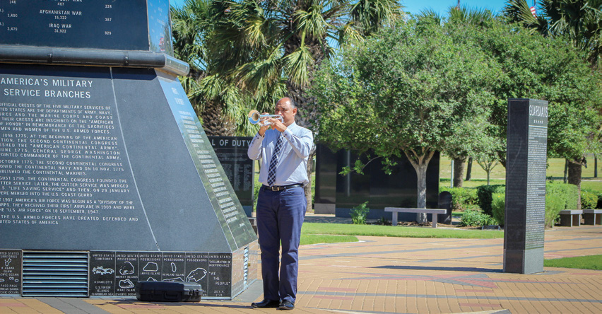 Man playing trumpet at Veteran's War Memorial in McAllen, Texas.