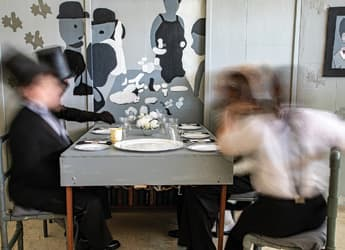 Photography project - blurred figures sitting at dinner room table