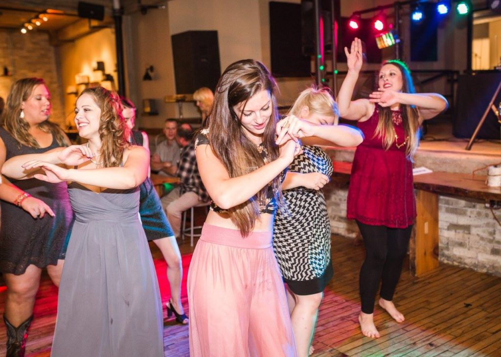 guests dancing on the dance floor at a wedding, doing the wobble