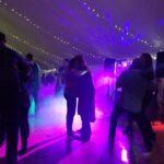 DJ Lighting with Fog machine at a backyard tented wedding in Wisconsin