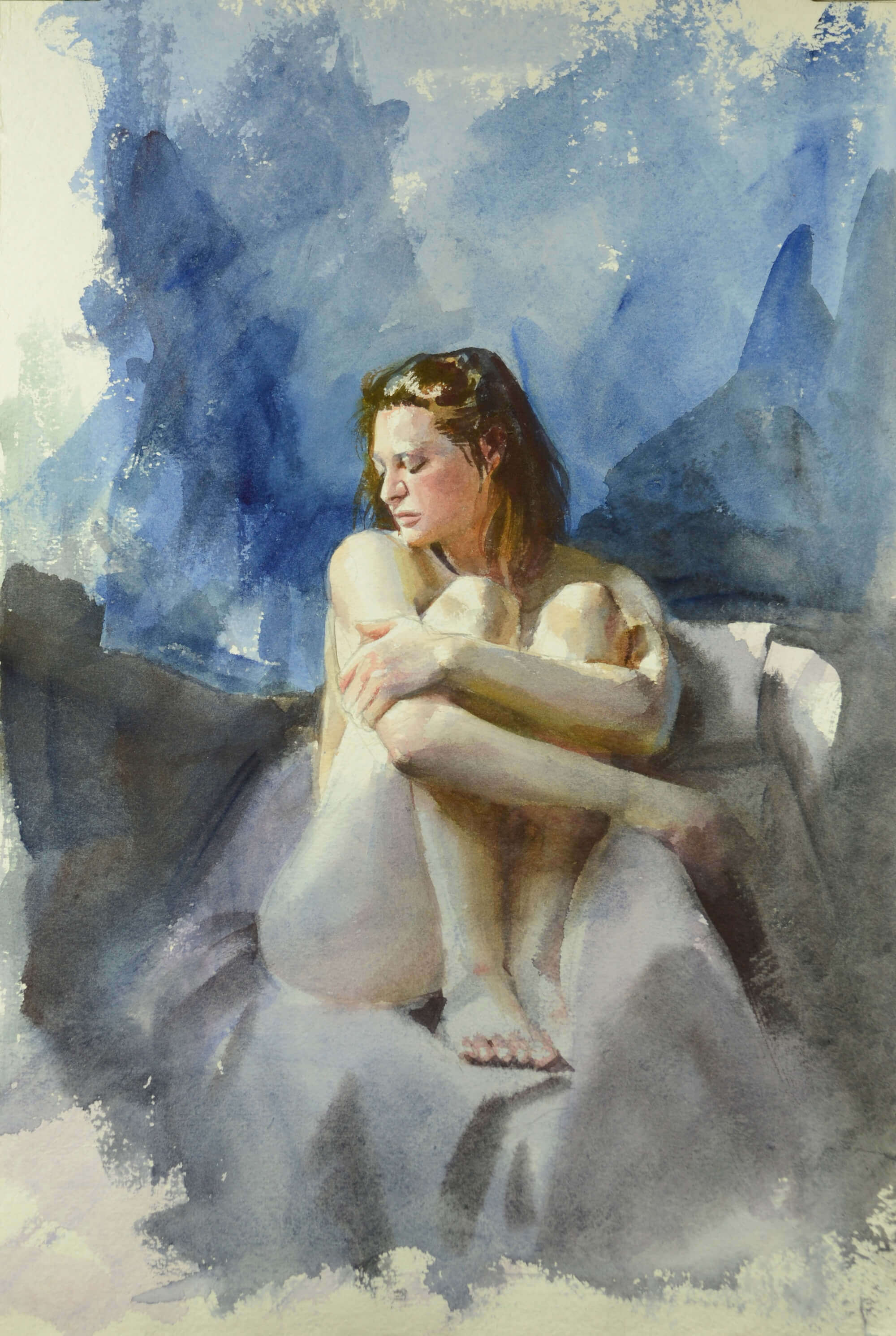 Figurative watercolor paining of a nude woman seated with her arms folded around her knees