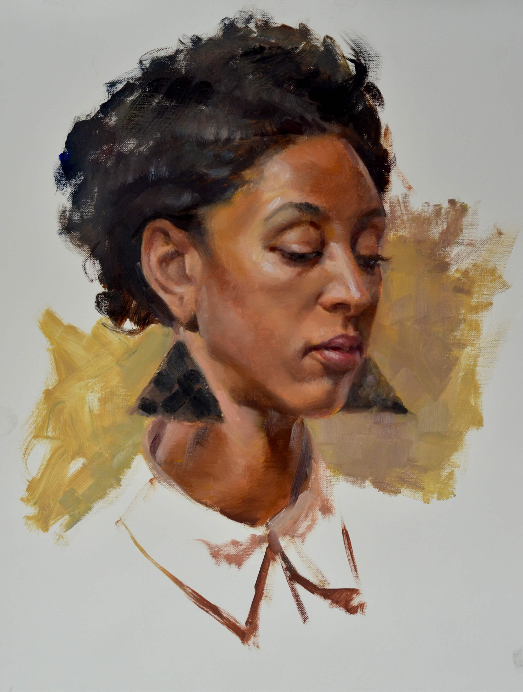 Portrait of a young woman wearing black triangle statement earrings
