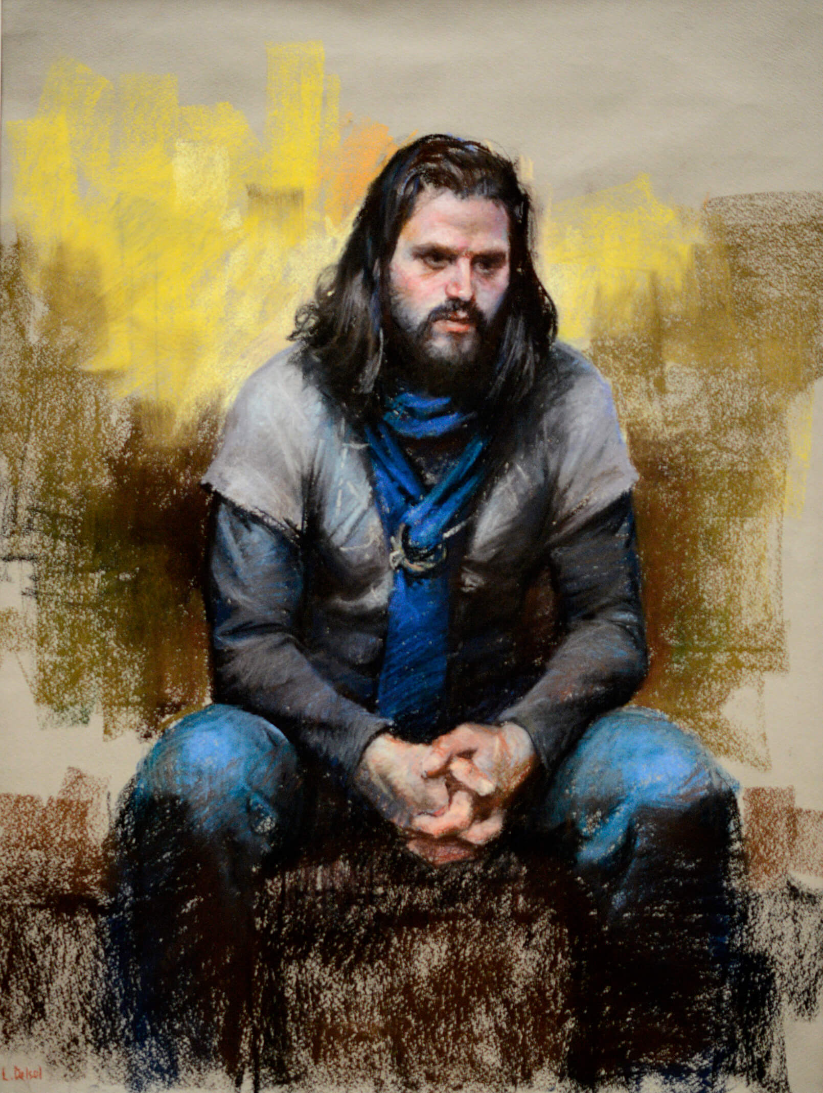 Pastel painting of a 30 something man with long brown hair, mustache and beard siting with his hands clasmped and a contemplative look. He is wearing a gray shirt with a blue scarf secured with an antique clasp. The blues in his clothing is balanced by energetic application of yellow in the background.