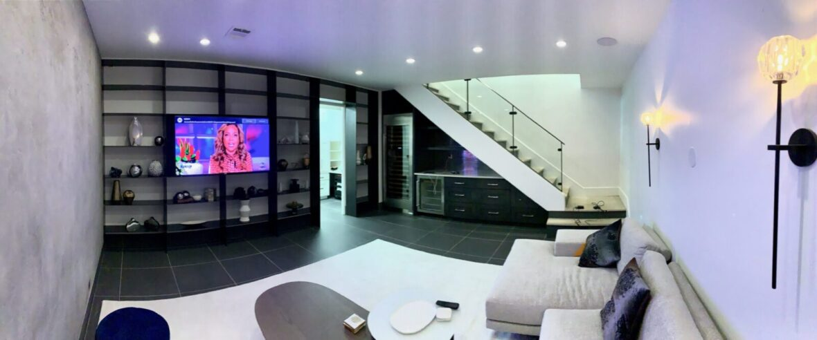 Media room with white wall's and in ceiling lighting and speakers