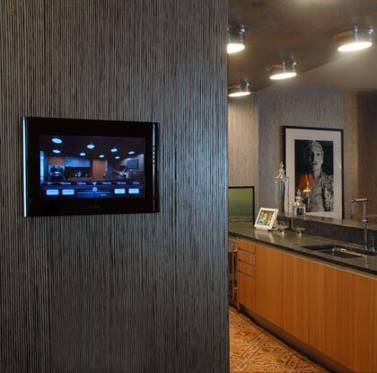 Automation touch pad installed into kitchen wall