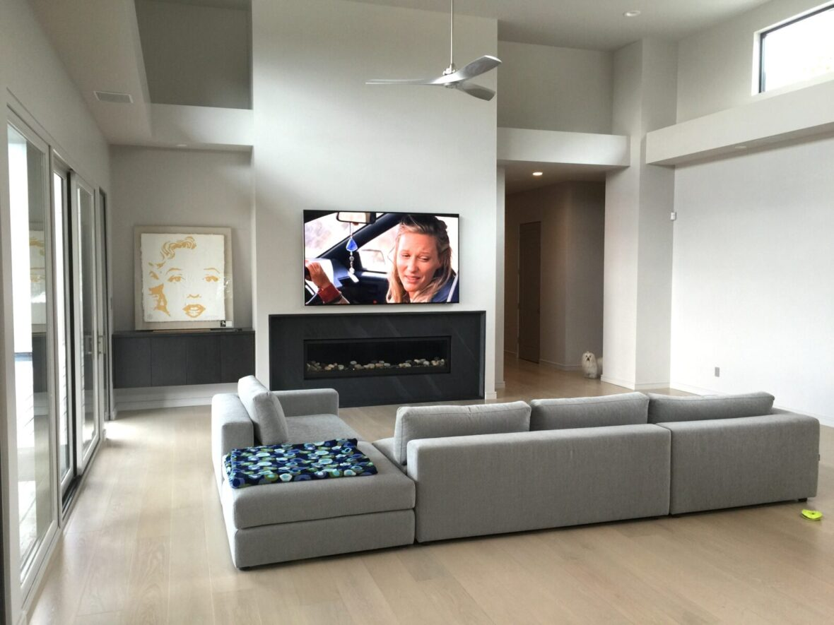 Media room mounted TV install, with Samsung framed TV mounted above fireplace with smart home automation control