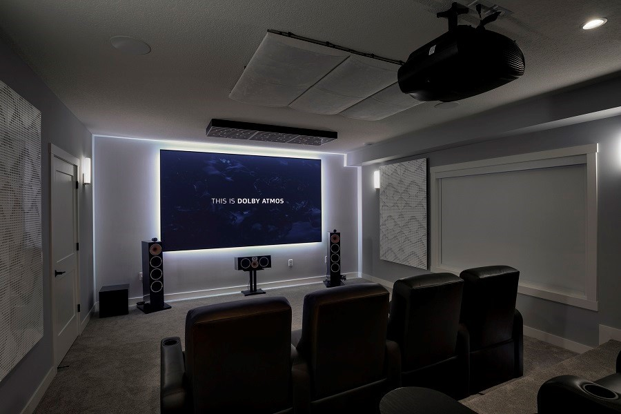 Home Theater with Custom Projection displaying across 80 inch tv, Led lighting with surround sound and acoustic paneling around walls.